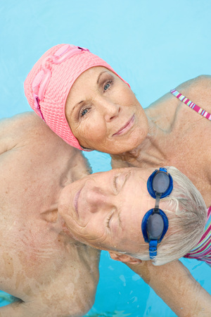 looking for love: Germany, Senior Couple In Swimming Pool