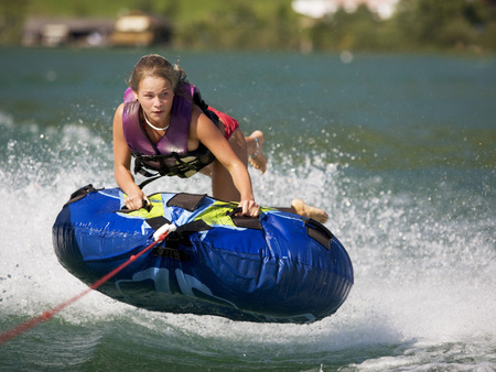 Austria, Moon Lake, Girl (16-17)  Riding Water Sled