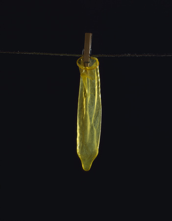 condones: Used Condom On Clothesline, Close-Up LANG_EVOIMAGES