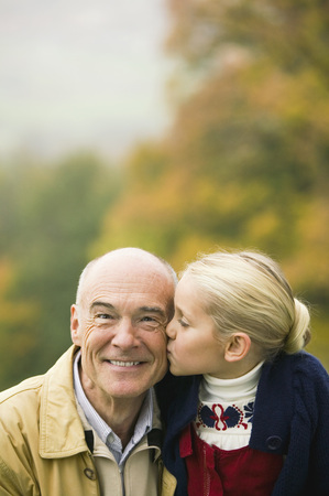 Germany, Baden-Wã¼Rttemberg, Swagrabian Mountains, Granddaughter Kissing Grandfather, Portrait LANG_EVOIMAGES