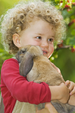 leporidae: Blonde Girl (4-5) With Curly Hair Holding Rabbit, Portrait