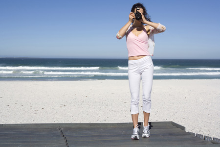 South Africa, Cape Town, Young Woman Taking Photograph, Portrait LANG_EVOIMAGES