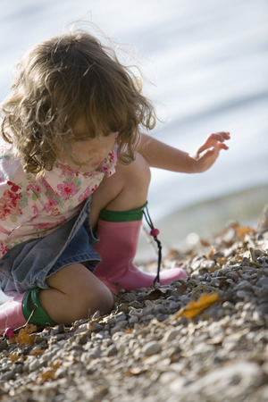 astonish: Germany, Bavaria, Ammersee, Little Girl (3-4) Playing On Beach