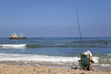 Africa, Namibia, Person Fishing, Rear View