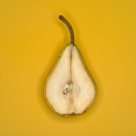disgusted: Rotting Pear Cut In Half, Elevated View
