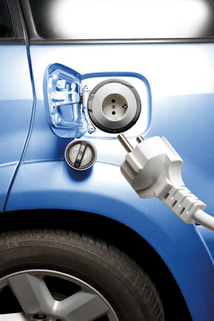 traction: Electric Plug And Electric Car, Close-Up LANG_EVOIMAGES