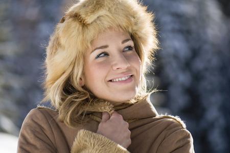 Austria, Salzburger Land, Altenmarkt, Young Woman Wearing Fur Hat Outdoors, Portrait LANG_EVOIMAGES