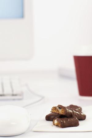 Chocolate Bars On Office Desk LANG_EVOIMAGES