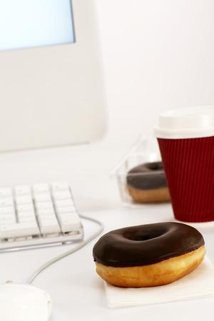 Donut On Office Desk LANG_EVOIMAGES