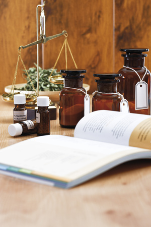 Homeopathic Book, In Background Apothecary Flasks