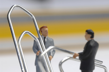 Paper Clips And Business Men Figurines LANG_EVOIMAGES