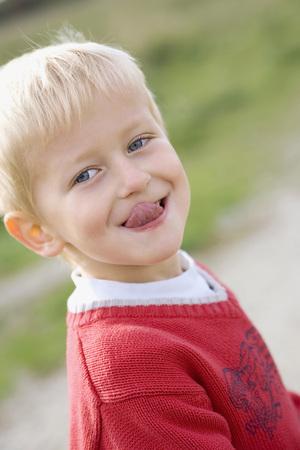 Little Boy (3-4) Poking His Tongue Out, Portrait LANG_EVOIMAGES