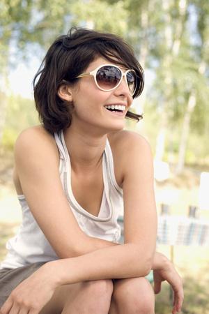 Germany, Leipzig, Ammelsrainer See, Woman Wearing Sunglasses, Portrait