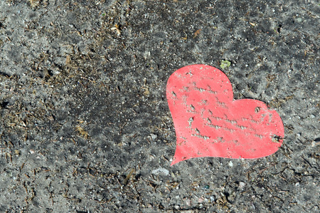 cruddy: Red Paper Heart On Ground,Elevated View LANG_EVOIMAGES