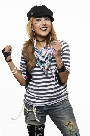 Young Woman With Cap And Earphones, Smiling, Listening To Music LANG_EVOIMAGES