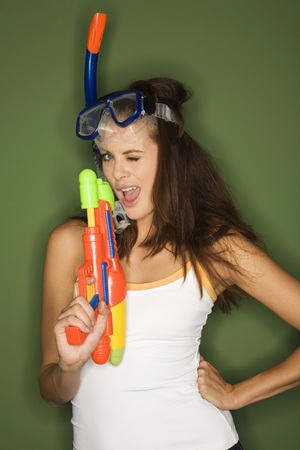 provoking: Young Woman Wearing Diving Goggles, Holding A Water Pistol