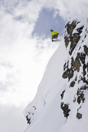 move in: Austria, Tyrol, Zillertal, Gerlos, Freeride Skiing, Man Doing Jump Across Rock
