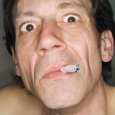 provoking: Man Smoking, Close-Up, Portrait LANG_EVOIMAGES