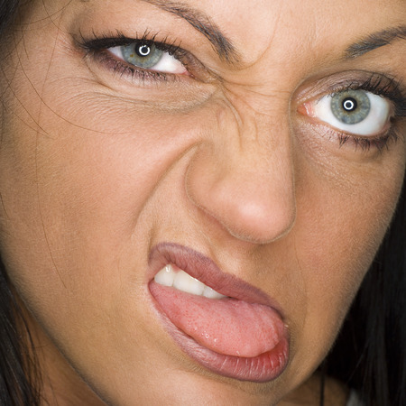 provoking: Portrait Of A Young Woman Making A Face, Close-Up