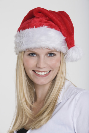 Young Woman Wearing A Santa Claus Hat, Portrait