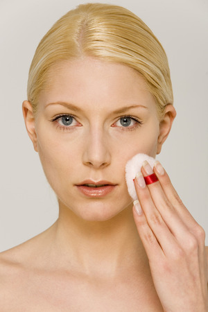 personal perspective: Young Woman Using Cotton Pad On Face, Portrait