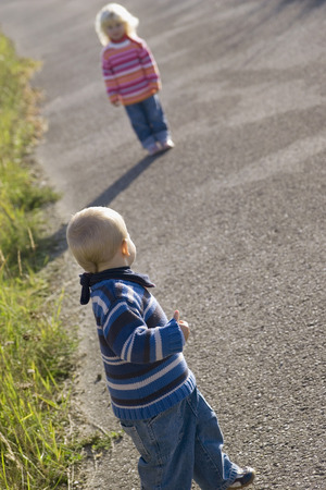 2 way: Little Girl (2-3) And Boy (1-2) Playing On Path, Rear View