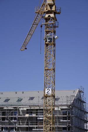 Germany, Bavaria, Munich, Construction Crane Next To Building LANG_EVOIMAGES