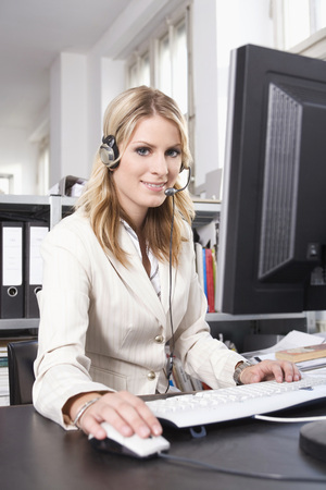 Young Woman With Headset, Using A Computer