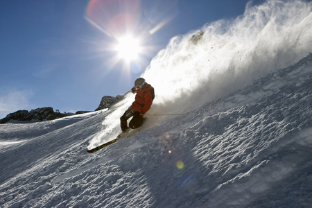 Austria, Tyrol, Stubaital, Man Skiing Downhill LANG_EVOIMAGES
