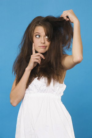 Young Woman Tearing Her Hair, Portrait LANG_EVOIMAGES