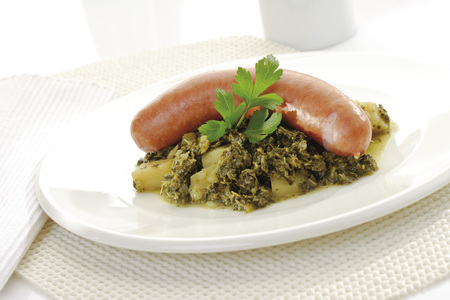 Curly Kale With Sausage And Potatoes On Plate LANG_EVOIMAGES