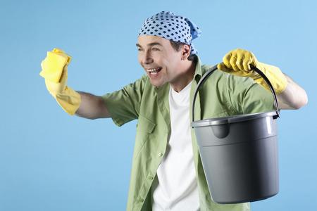 Man Holding Bucket And Sponge, Smiling, Portrait LANG_EVOIMAGES