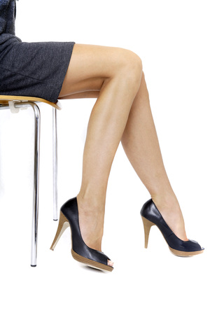 Young Woman In Mini Dress Sitting On Chair, Middle Section