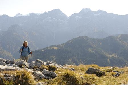 Austria, Karwendel, Rissbachtal, Woman Nordic Walking