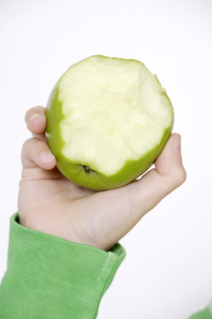 Child Holding An Apple Bitten Off,Close Up