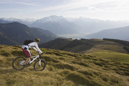 Austria, Salzburger Land, Zell Am See, Woman Mountain Biking