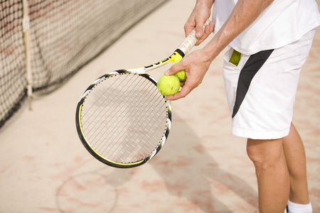 Male Tennis Player Holding Tennis Racket,Low Section LANG_EVOIMAGES