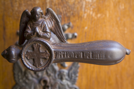 Iron Door Handle, Angel-Shaped, Close Up LANG_EVOIMAGES