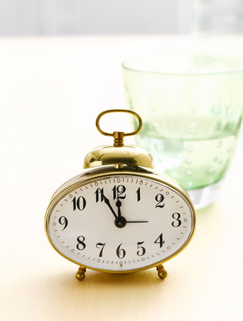 Alarm Clock And Water Glass, Close-Up