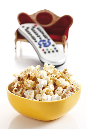 Popcorn In Bowls With Remote Control And Sofa, Close-Up
