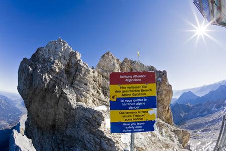Germany, Bavaria, Wetterstein Mountains, Zugspitze, Summit Cross, Warning Sign