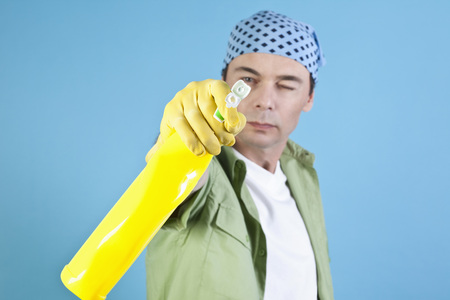 Man Holding Cleaning Agent, Portrait LANG_EVOIMAGES