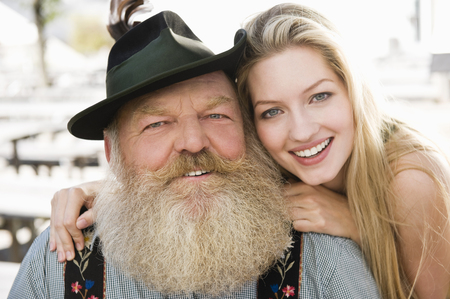 Germany,Bavaria,Upper Bavaria,Senior Man And Young Woman,Smiling,Portrait,Close-Up LANG_EVOIMAGES