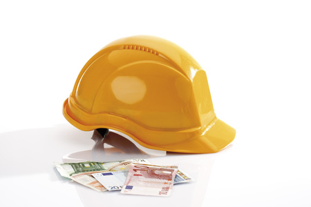 Hardhat And Different Euro Bank Notes In Foreground