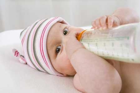 Baby Boy (6-9 Months) Drinking Milk From Bottle, Portrait