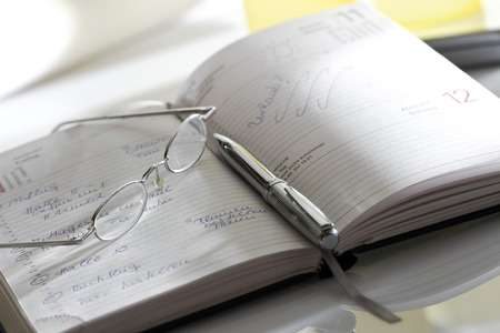 Notebook, Eyeglasses And Pen, Close-Up