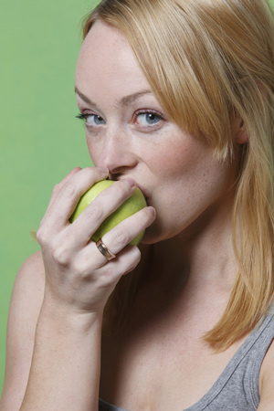 sorts: Young Woman Biting Into An Apple, Portrait