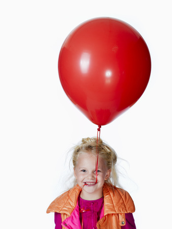 Girl (8-9) Holding Red Balloon, Portrait