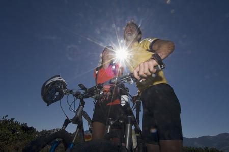 mtb: Austria, Salzburger Land, Couple On Mountain Bikes Laughing