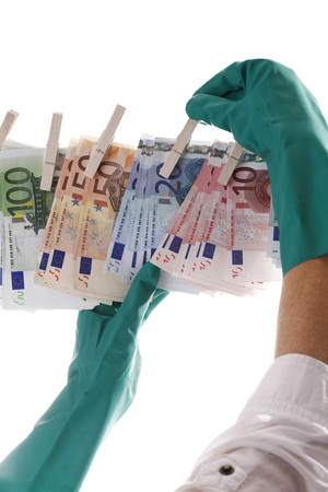 Person Hanging Different Euro Notes On Clothesline, Close-Up